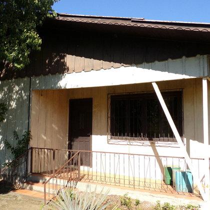Residência mista com 7 dormitórios, sob terreno de 640,00 m², localizada no bairro Picada Holanda, município de Picada Café-RS